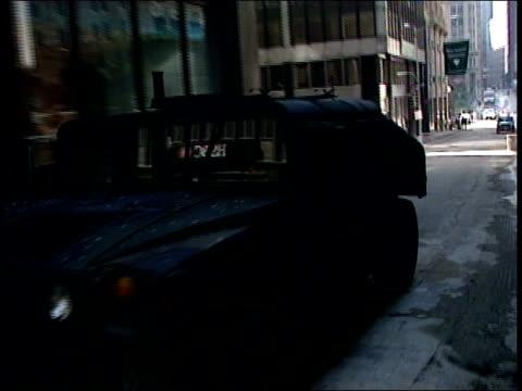 humvee driving down street / antibin laden graffiti written in dust on window - humvee stock videos & royalty-free footage