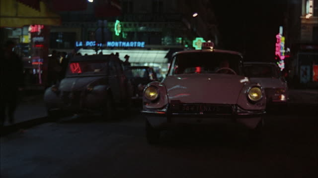 1966 rear pov driving down street at night / london, united kingdom - 1966 stock videos and b-roll footage