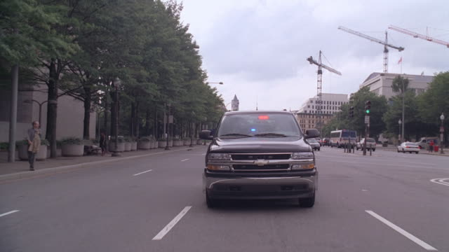 ts suv driving down streets of washington d.c. / washington, district of columbia, united states - motorcade stock videos & royalty-free footage