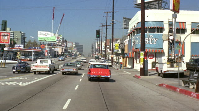 stockvideo's en b-roll-footage met pov driving down sunset strip / hollywood, california, usa - 1965