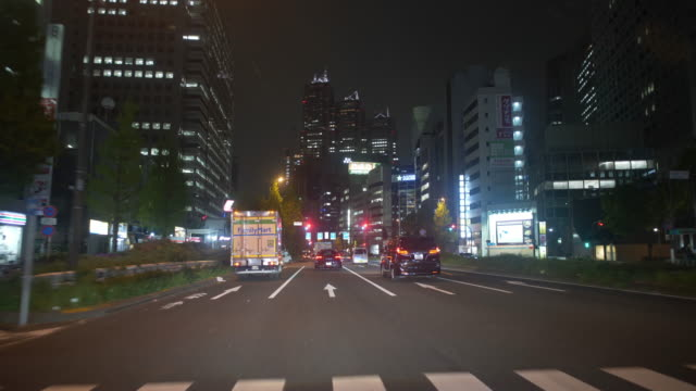 driving down the street in shinjuku, tokyo at night - riding stock videos & royalty-free footage