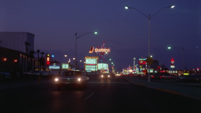 ws rear pov driving down the strip at dusk / las vegas, nevada, usa - ladenschild stock-videos und b-roll-filmmaterial
