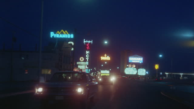 ws rear pov driving down the strip at night / las vegas, nevada, usa - 1968 stock videos and b-roll footage