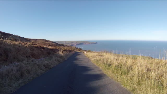 driving down towards robin hood's bay in north yorkshire - sea robin stock videos & royalty-free footage