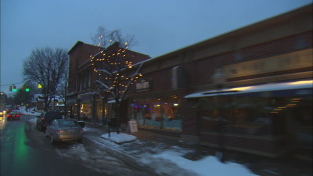 pov driving down town street at dusk in winter, milford, michigan, usa - michigan stock videos and b-roll footage