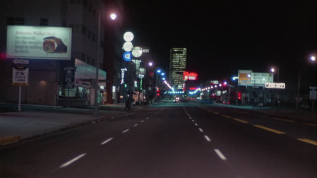 ws rear pov driving down wilshire blvd at night / los angeles, california, usa - 1967 stock videos & royalty-free footage