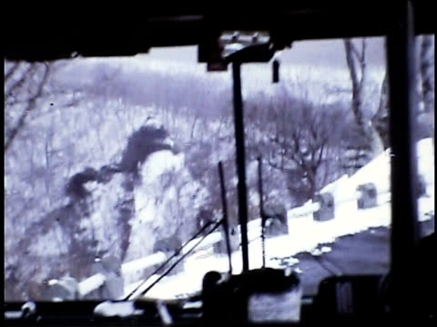 / pov driving down winding road with snowy mountains in the background driving down snow mountain roads on january 01 1973 in japan - winding road stock videos & royalty-free footage