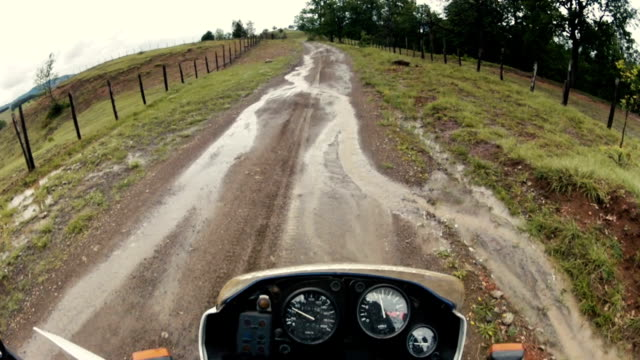 Driving enduro motorcycle on mountain road