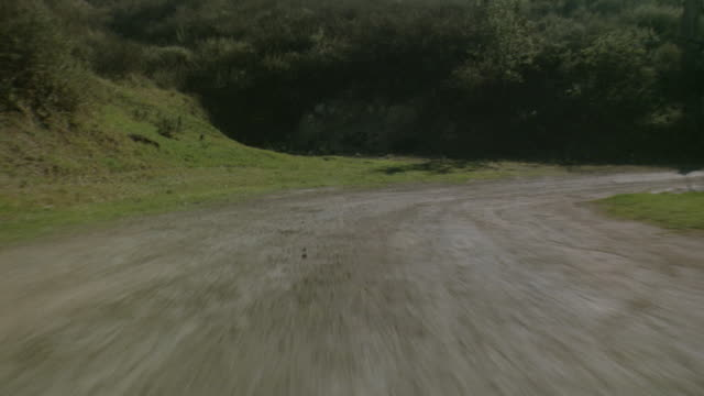 car pov driving fast down rural dirt road - personal land vehicle stock videos & royalty-free footage