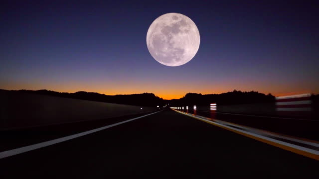 driving fast, full moon on the road - vanishing point stock videos & royalty-free footage