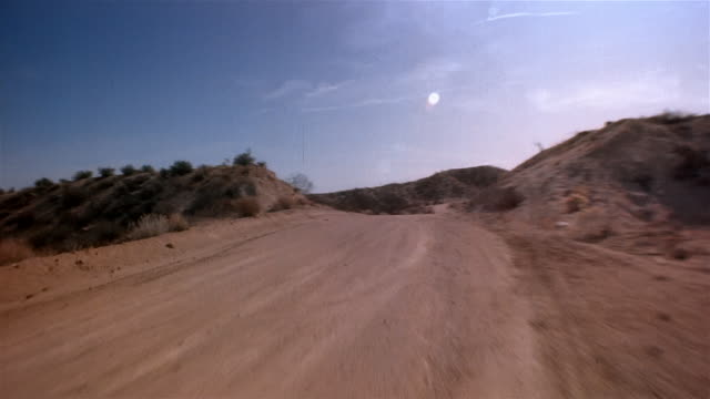pov, driving fast through mojave desert, california, usa - desert stock videos & royalty-free footage