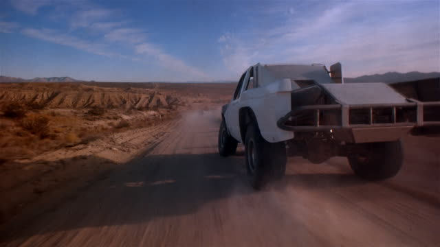 pov, driving fast through mojave desert, california, usa - pursuit concept stock videos & royalty-free footage