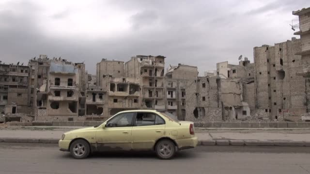 Driving fearlessly under skies free of warplanes and bombs taxi drivers in Syrias divided second city Aleppo are counting on a fragile truce to...