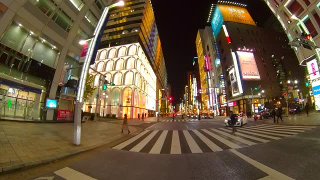 driving ginza street at night, tokyo, japan. - plusphoto stock videos & royalty-free footage