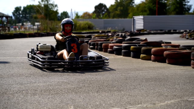 driving go-cart,super slow motion video - hard hat stock videos & royalty-free footage