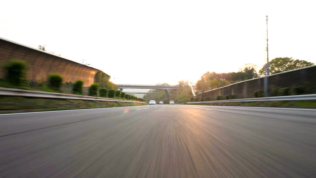 Driving highway at dusk,Rear View