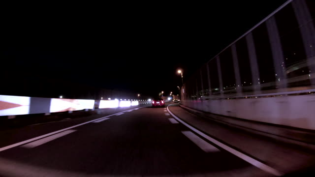 driving highway at night - concorrente video stock e b–roll