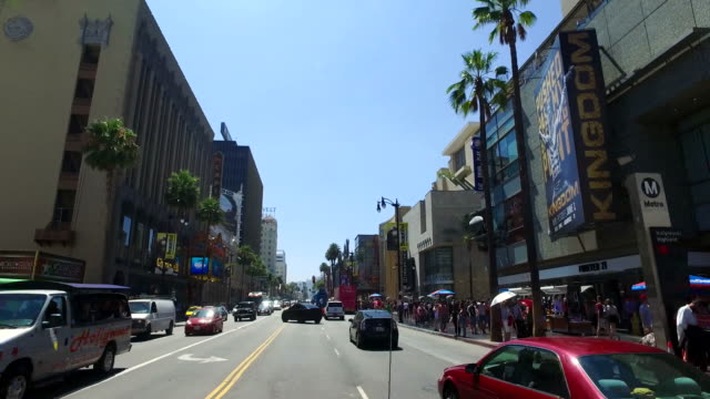 vidéos et rushes de driving hollywood boulevard by highland avenue  4k transportation - hollywood boulevard