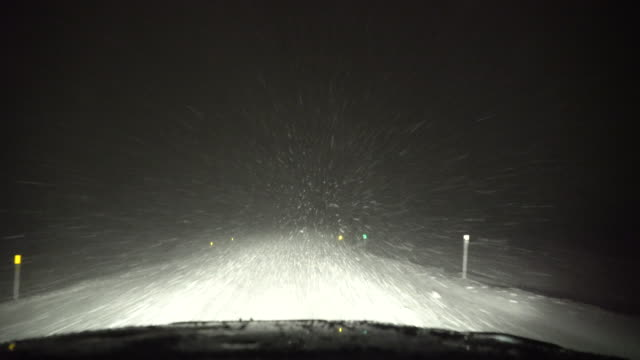 driving in a blizzard at night, whiteout conditions, treacherous travel - car dash pov - schneebedeckt stock-videos und b-roll-filmmaterial