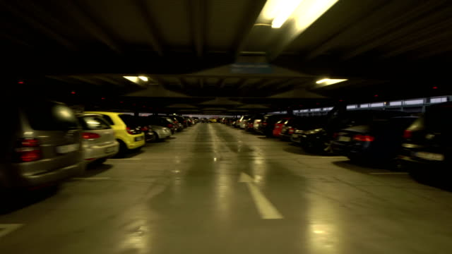 POV Driving in a multi-storey car park at dusk