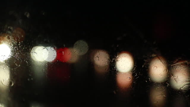 stockvideo's en b-roll-footage met driving in a rain storm at night - voorruit