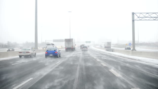 driving in a snow storm, canada - heavy goods vehicle stock videos & royalty-free footage