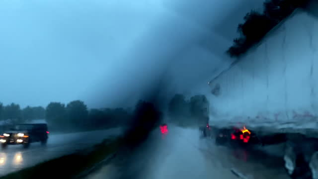 driving in a storm with rain on windshield and fast moving windshield wipers - headlight stock videos & royalty-free footage