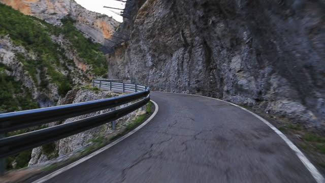 driving in a stunning mountain road in the pyrenees. - mountain road stock videos & royalty-free footage