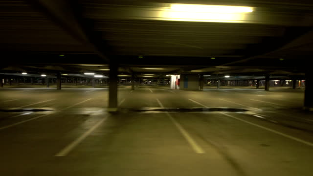 pov driving in an empty car park - viewpoint stock videos and b-roll footage