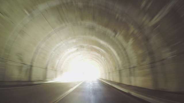 pov driving in and out the tunnel - point of view video stock e b–roll
