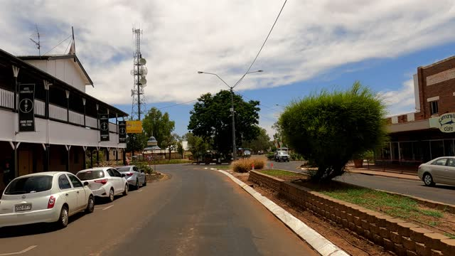 driving in country town main street, outback australia - outback stock videos & royalty-free footage