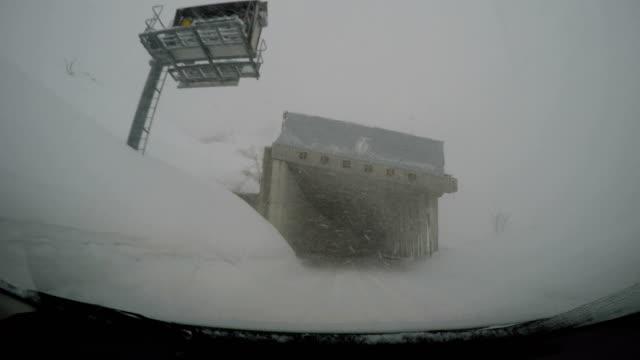 Driving in hazardous winter storm conditions with strong wind and heavy snow in northern Japan