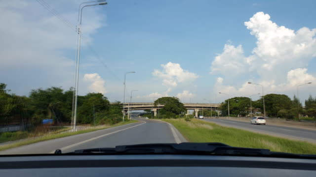 driving in highway between city in thailand. - furgone pickup video stock e b–roll