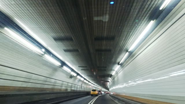 driving in holland tunnel, from driver point of view - fanale anteriore video stock e b–roll