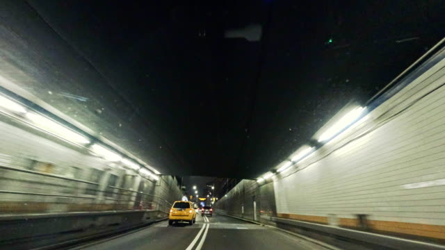 driving in holland tunnel, from driver point of view - car point of view stock videos & royalty-free footage