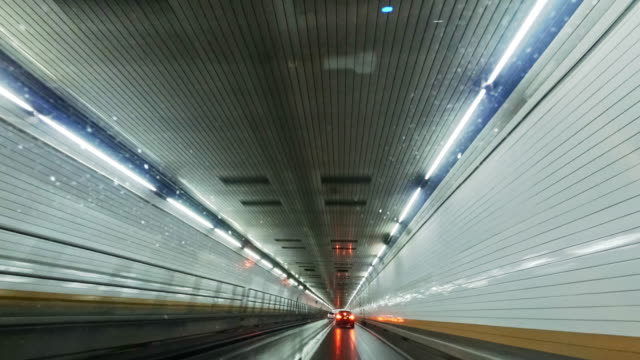 driving in holland tunnel, from driver point of view - relocation stock videos & royalty-free footage