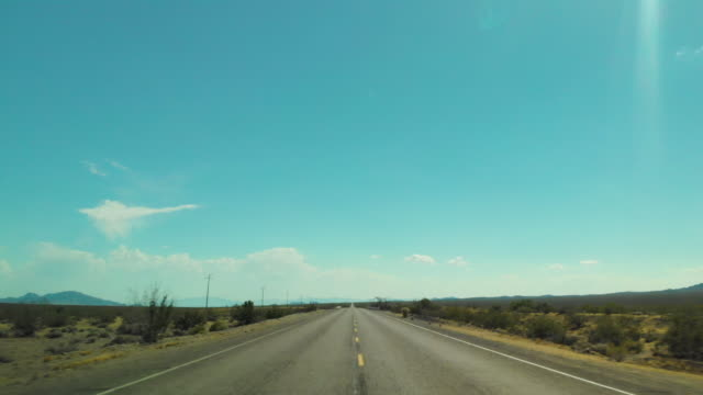 pov driving in joshua tree desert route 66 - vanishing point stock videos & royalty-free footage