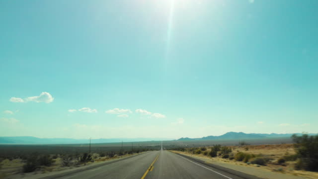 pov driving in joshua tree desert route 66 - diminishing perspective stock videos & royalty-free footage