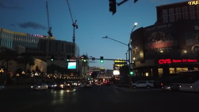 driving in las vegas at twilight, new hotel construction cranes in the background - road signal stock videos & royalty-free footage
