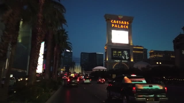 driving in las vegas at twilight - caesars palace las vegas stock videos & royalty-free footage