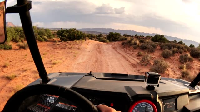 driving in moab with an atv car - off road vehicle stock videos & royalty-free footage