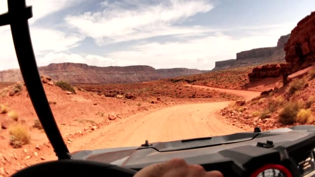 driving in moab with an atv car - moab utah stock videos & royalty-free footage