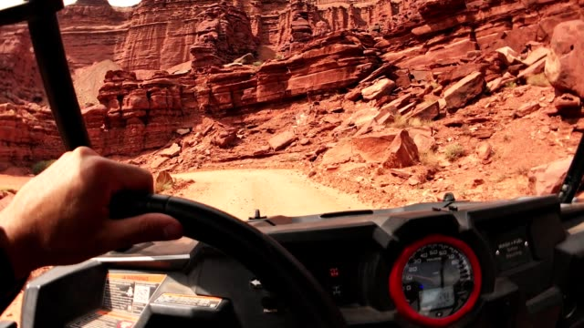 driving in moab with an atv car - off road car stock videos and b-roll footage