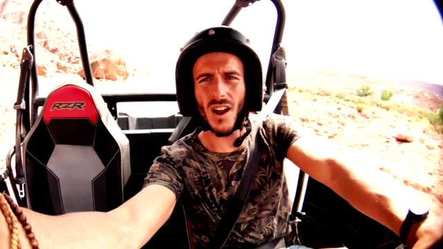 driving in moab with an atv car - quadbike stock videos & royalty-free footage