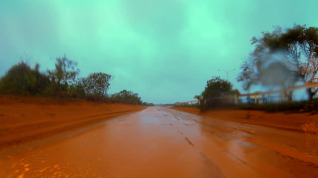 driving in mud and flood water as cyclone blake dumps heavy rain in western australia - dirt track stock videos & royalty-free footage
