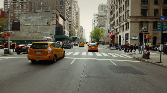 pov driving in new york city - taxi stock videos & royalty-free footage