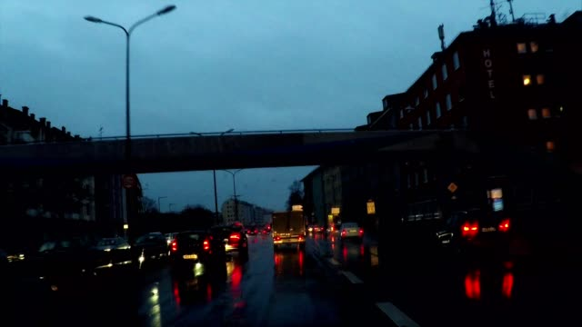 driving in rain at night on highway under overpasses, munich, germany - high point video stock e b–roll