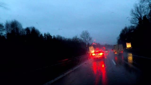 stockvideo's en b-roll-footage met driving in rain at night through a dark forest in winter, germany, europe - gevaar