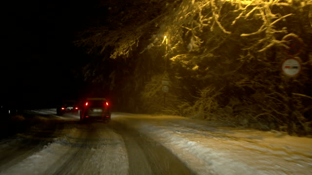 driving in snow at night - peter snow stock videos & royalty-free footage