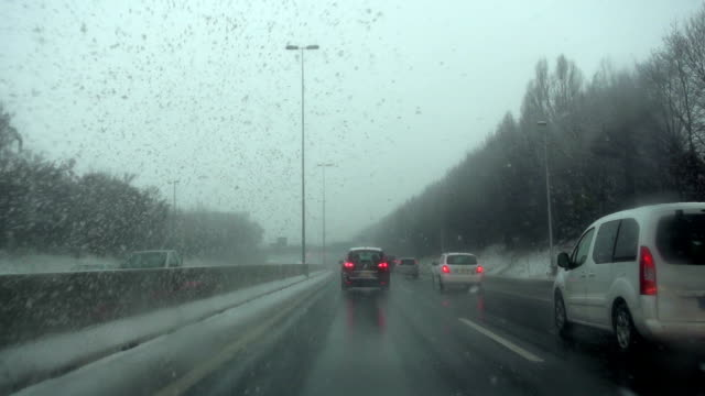driving in snow on a highway - peter snow stock videos & royalty-free footage